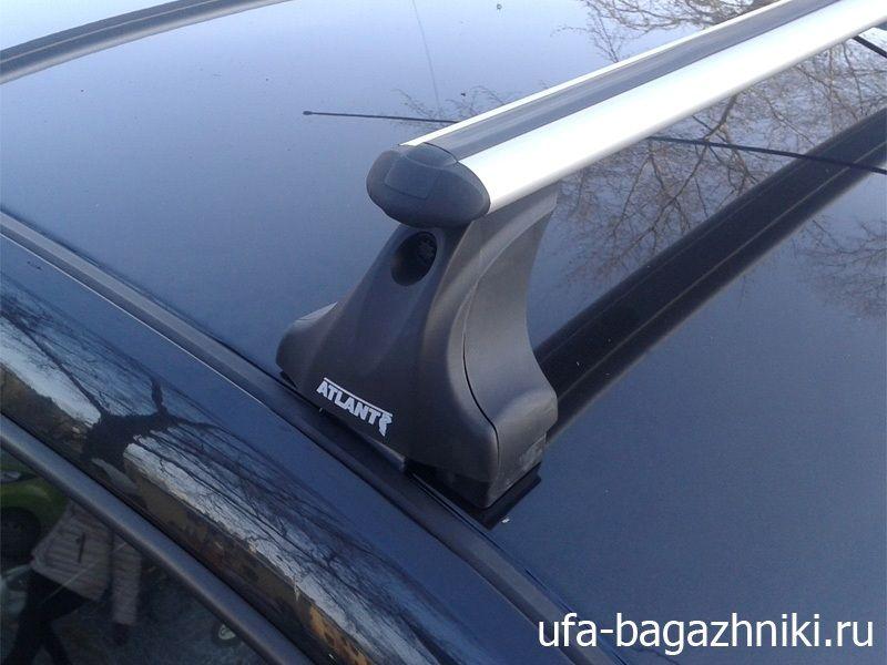 Багажник на крышу Renault Sandero, Атлант, аэродинамические дуги, опора Е