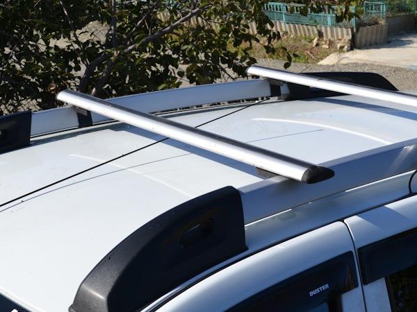 Багажник на крышу Renault Duster 2, Атлант, крыловидные дуги на рейлинги