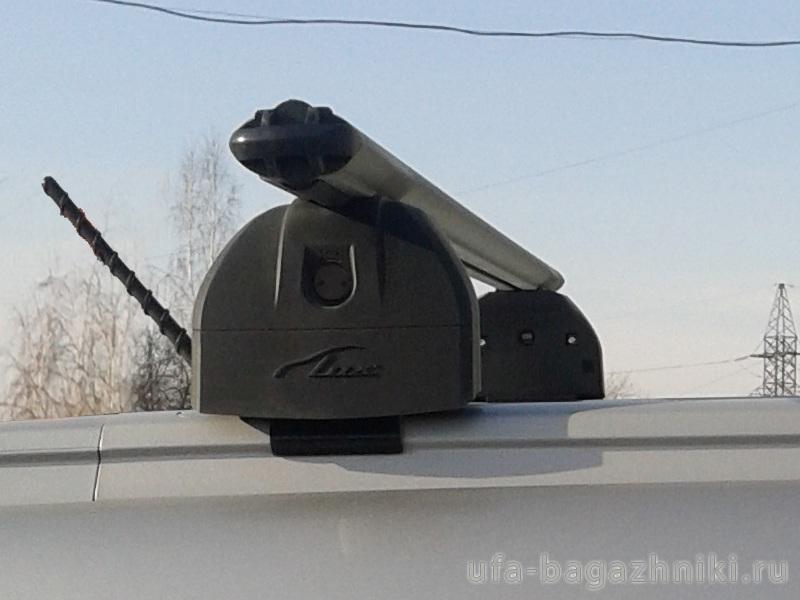 Багажник на крышу Geely Atlas 2017-..., Lux, аэродинамические дуги (53 мм) на интегрированные рейлинги